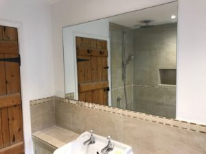 6mm silver mirror polished all round glued to wall fitted near Shaftsbury