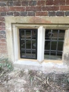 Traditional Leadlights rebiult and fitted into stone mullions near Salisbury