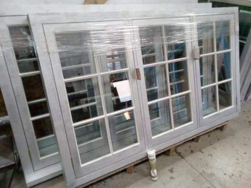 Slim double glazed units fitted to timber frames using acrylic putty